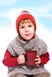 Boy with cup Stock Photos