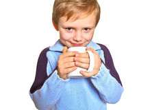 Boy with a cup. Young boy holding a cup Stock Photos