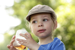 Boy with cup of tea Royalty Free Stock Image