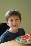 Boy with cupcakes Royalty Free Stock Photo