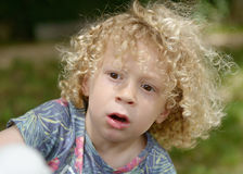 Boy with curly blond hair, outside. Boy with curly blond hair, to the outside Royalty Free Stock Images