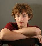 Boy with curly hair, portrait stock photography