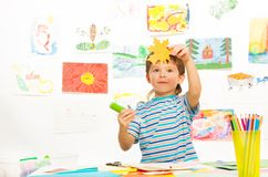 Boy cut and glue Royalty Free Stock Photo