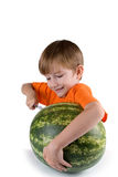 Boy cut watermelon Royalty Free Stock Images