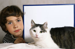 Boy and cute cat with empty paper sheet in frame Stock Image