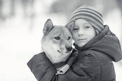 Boy and  cute dog on winter walking Royalty Free Stock Photos