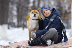 Boy and  cute dog on winter walking Stock Photo