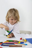 Boy cutting paper Stock Image