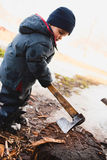 Boy cutting wood Stock Photos