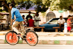 Boy on cycle, panning rahagiri. Delhi, India; 10th Aug 2014 - Panning shot of boy on bicycle at Rahagiri day in Gurgaon. Captures the fast speed with almost no Stock Photo