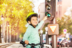 Boy cycling on his bike and learning traffic rules stock photo
