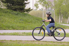 Boy cycling in park royalty free stock image