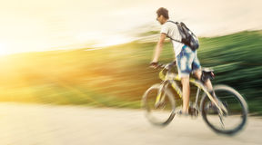 Boy cyclist in traffic on the city roadway Royalty Free Stock Photography