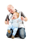 Boy with dad. Little boy playing with his dad on white background stock images
