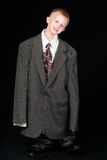 Boy in Dad's Business Suit Stock Image