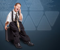 Boy in daddy business suit Stock Photos