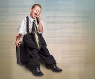 Boy in daddy business suit Stock Photo
