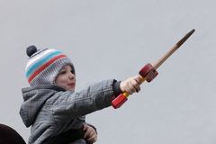 Boy with a dagger toy Stock Images