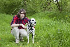Boy and the dalmatian dog Royalty Free Stock Images