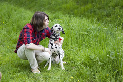 Boy and the dalmatian dog Stock Photo