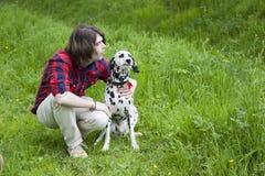 Boy and the dalmatian dog Stock Photo