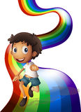 A boy dancing above the rainbow Stock Images