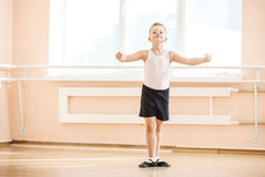 Boy dancing at a ballet class. Young boy dancing at a ballet class stock photo