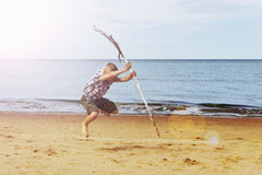 Boy dancing on the beach Stock Images