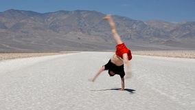 Boy dancing breakdance in the famous Death Valley USA stock video footage