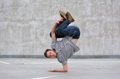 Boy dancing breakdance on the street Stock Photos