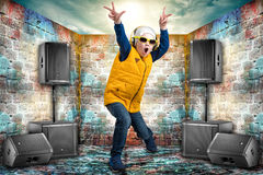 Boy dancing Hip-Hop . Children`s fashion.The Young Rapper.Cool rap DJ. Boy dancing Hip-Hop . Children`s fashion royalty free stock photos
