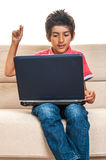 Boy dancing listening musig on laptop computer Stock Image