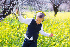 Boy dancing with PC tablet Royalty Free Stock Photos