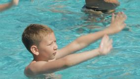 Boy is dancing in the pool stock video footage