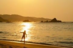 Boy dancing in the rising sun. Young boy playing in the rising sun at Mazunte beach, Oaxaca, Mexico Stock Photography