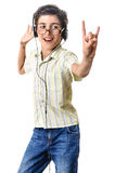 Boy dancing rock sign listening at headphones Stock Photography