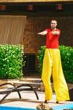 Boy dancing on stilts Stock Images