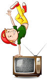 Boy dancing on television Stock Images