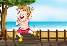 A boy dancing on a wooden platform Stock Photos