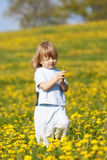 Boy with a dandelion Stock Photo