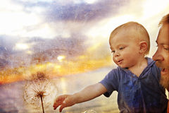Boy and dandelion Royalty Free Stock Photos
