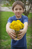 Boy with Dandelion Bouquet Royalty Free Stock Photo