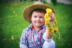 The Boy with dandelion Stock Photos