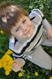 A boy with a  dandelions Stock Photo