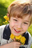 Boy with Dandelions Royalty Free Stock Photography