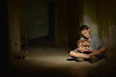 Boy in a dark cellar Royalty Free Stock Images