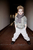 Boy in the dark corridor Stock Images