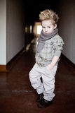 Boy in the dark corridor Royalty Free Stock Images