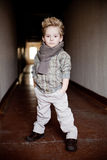 Boy in the dark corridor Royalty Free Stock Image