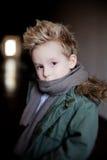 Boy in the dark corridor Royalty Free Stock Photography